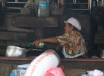 Lady cooking at Taling Chan Floating Marketing, Bangkok