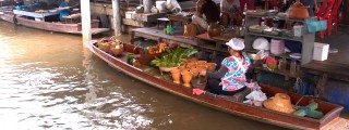 Women preparing food at Taling Chan floating market